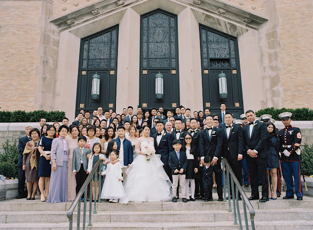 The whole family in front of the church after the wedding in Island Park NY