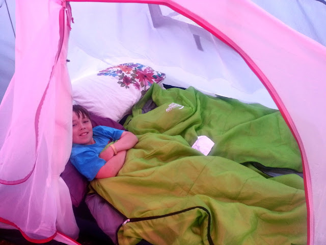Boy in Sleeping Bag inside Tent