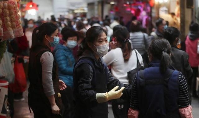 Orang Kristen menghadapi risiko coronavirus untuk berkhotbah di jalan-jalan Wuhan, Cina