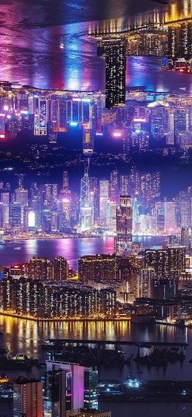 خلفية ناطحات سحاب المدينة المضيئة وقت الليل