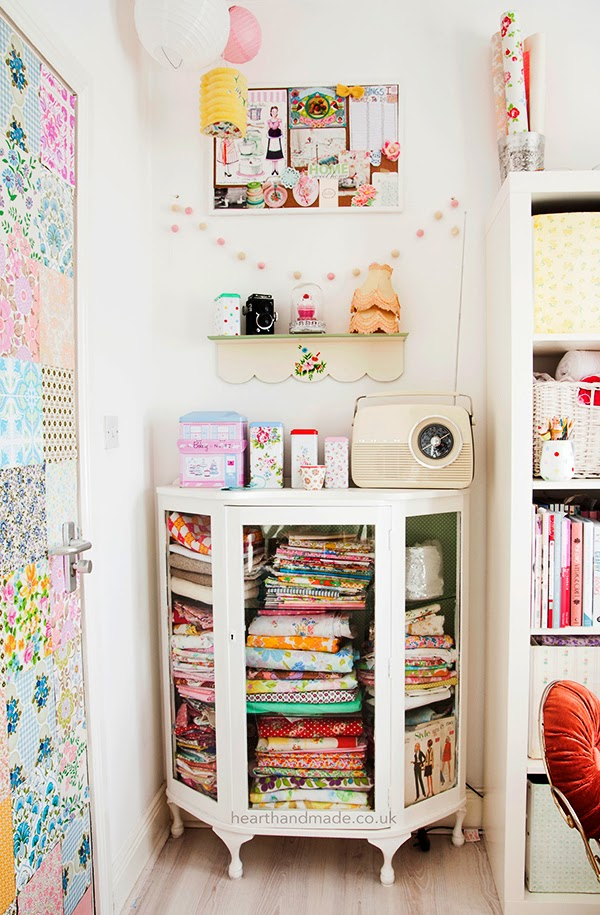 painted upcycled vintage fabric cabinet and patchwork door in the craft room