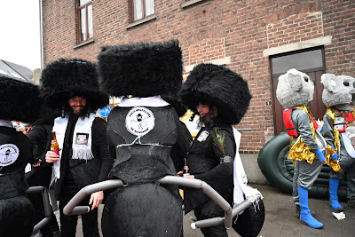 Participants of the Aalst Carnival wearing costumes combining haredi Jew clothes with ant parts at the event in Aalst, Belgium on Feb. 23, 2020. (Cnaan Liphshiz)