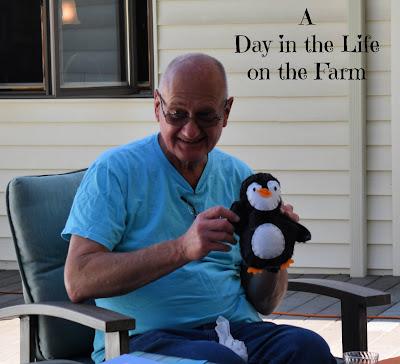 Man holding stuffed penguin