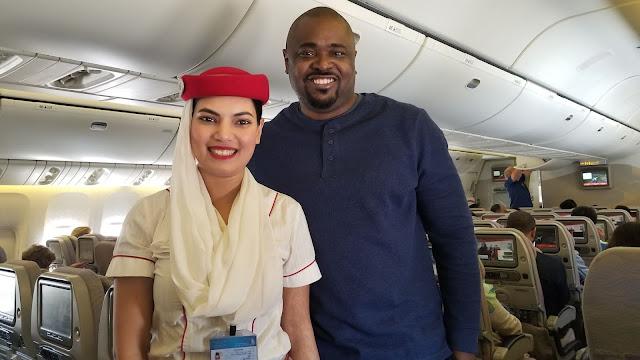 Emirates Flight Attendant and Passenger on plane