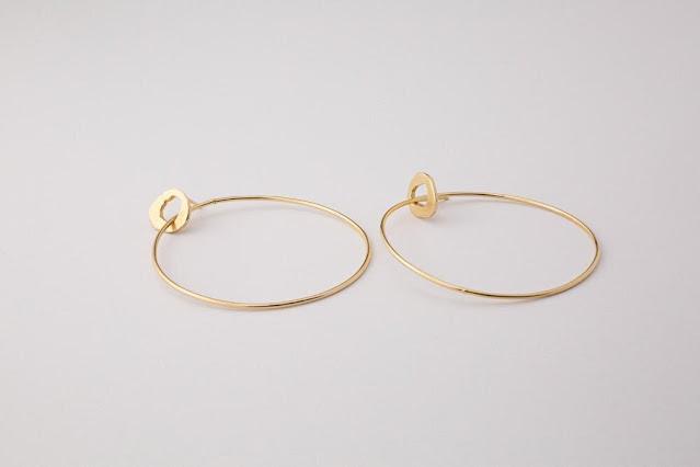 Interlocking gold hoop earrings from Supply Chain Seattle