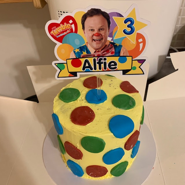 Bespoke Mr Tumble birthday cake with personalised topper