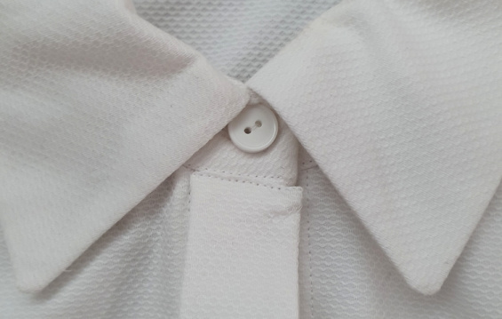 close up of a white collar shirt