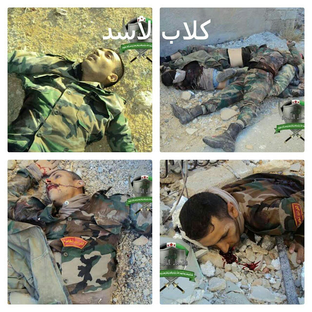 Νεκρά μέλη του καθεστώτος με εμβλήματα της al-Quwat al-Haras