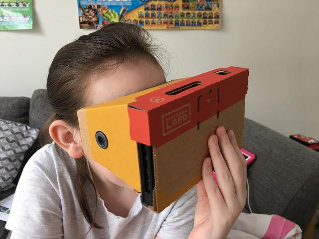sasha holding VR goggles