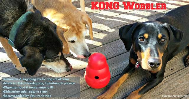 3 rescue dogs with interactive Kong Wobbler toy