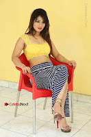 Cute Telugu Actress Shunaya Solanki High Definition Spicy Pos in Yellow Top and Skirt  0466.JPG
