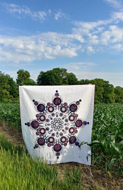Flurry quilt - giant modern snowflake quilt with raw edge applique