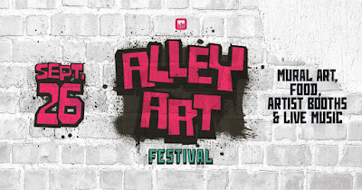 """the words """"Alley Art"""" and """"sept 26"""" appear as if they are spray painted in red and black against a gray wall"""
