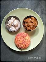 A special lunch platter consisting of beetroot rice, spicy chicken curry and shahi paneer