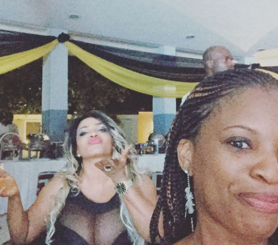 2 Photos: Cossy Orjiakor exposes B**b$ once again at a party in Abeokuta
