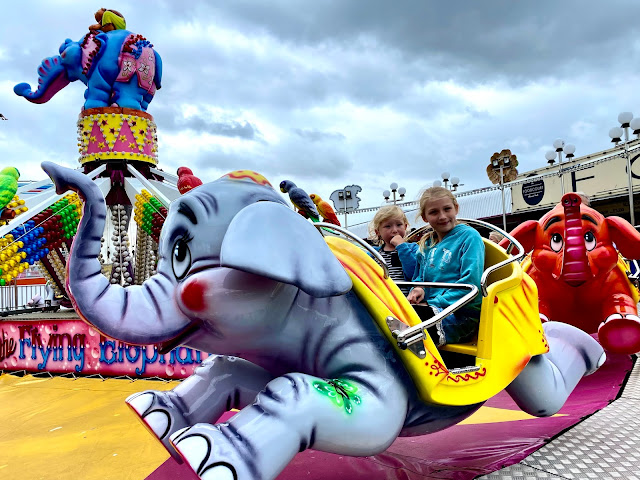 Two children sitting on the flying dumbo ride at Great Yarmouth pleasure beach