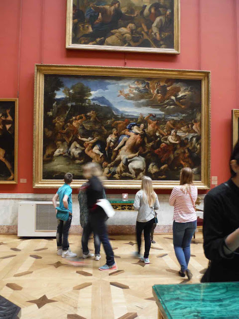 People look at art at the Hermitage Museum