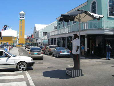 Police officer directing traffic on Bay St., Nassau, Bahamas.