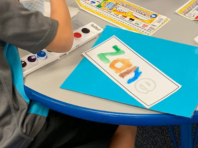Watercolor name painting for literacy stations
