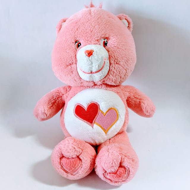 pink bear doll on white background