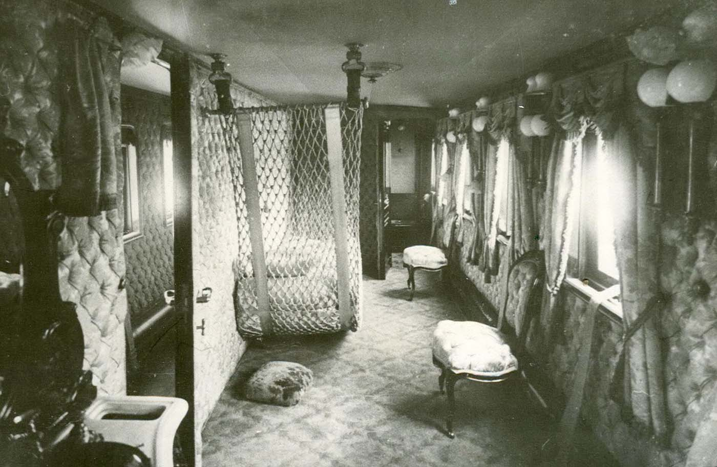 The walls and furnishings were upholstered, mainly in English cretonne with plant ornaments.
