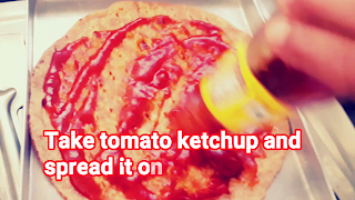 image of putting tomato ketchup on roti