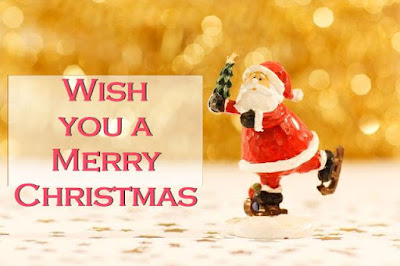 Santa Clause Figurine Image on background Merry Christmas written on it.
