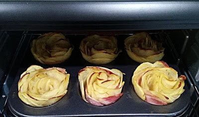 Potato roses ready for baking in the oven