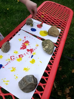 Child making process art with wildflowers