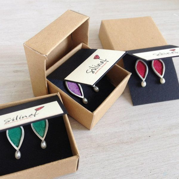 packaging for three pairs of silver, painted paper, and pearl earrings by Silina
