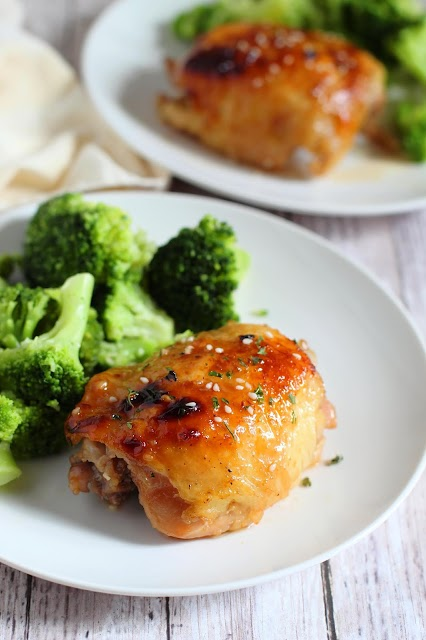 chicken thigh on a plate with broccoli.