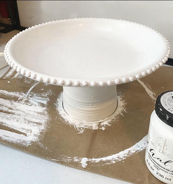 white painted pedestal dish