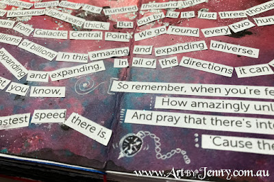 closeup of the lyrics for Galaxy Song on the galaxy mixed media artwork by Jenny James