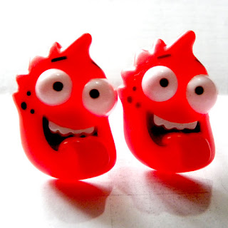 Red plastic monster rings from Greggs with googly eyes