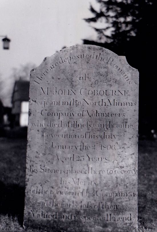 With its lettering still clear bold the head-stone to Mr. John Cobourne, sergeant in the local volunteers, stands near the porch of North Mymms church Image by Dorothy Colville, part of The Peter Miller Collection