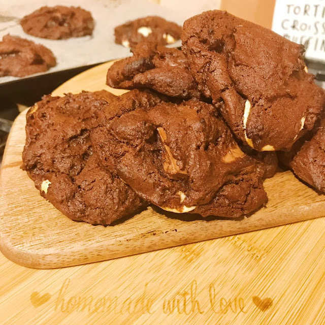 triple chocolate cookies on chopping board