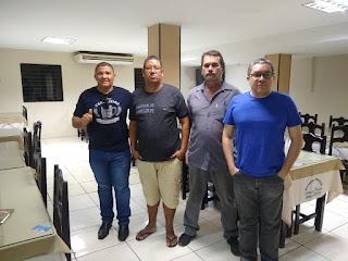Egmon Família Moura, primeiro à esquerda