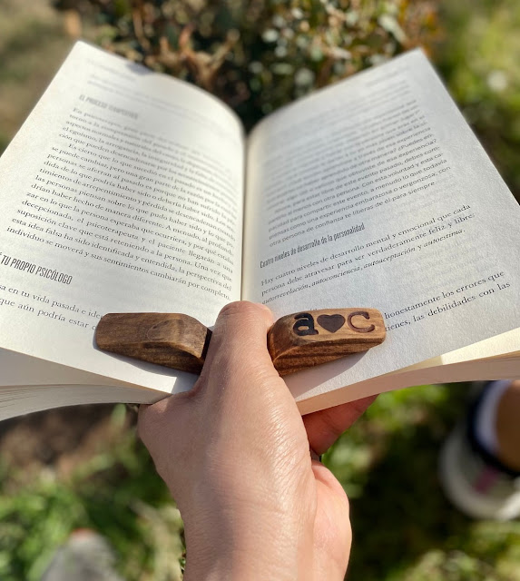Wooden book holder frees your other hand to handle a mug or glass or whatever needs handling!