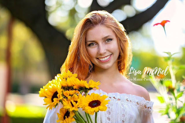 teen girl red hair holding daisies