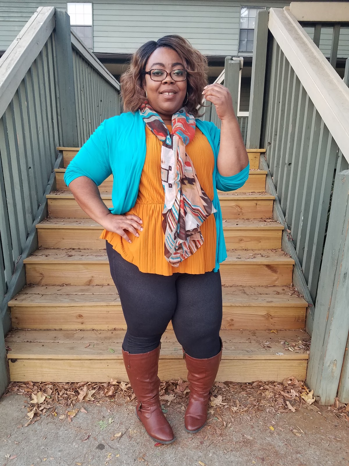 pleats, peplum hem, mustard blouse, teal cardigan, fringe bag, scarf accessory, cognac boots, thick thighs