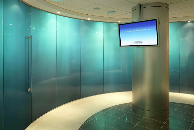 Curved glass shopping center partition