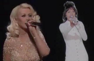 Watch Christina Aguilera perform Im Every Woman with Whitey Houston's hologram on The Voice now at JasonSantoro.com