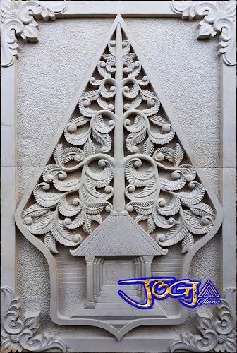 relief kayon dari batu alam putih gambar kayon / gunungan motif daun