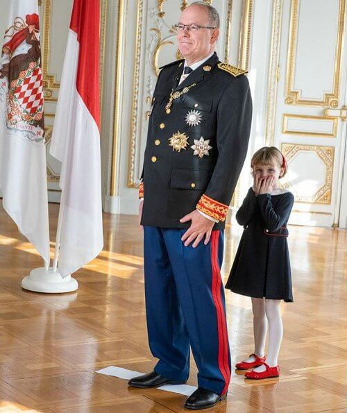 Princess Charlene wore a coat from Terrence Bray. Gabriella wore a dress from Jacadi