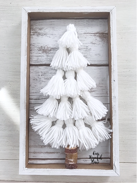 white yarn tassels CHristmas tree wood slice tree trunk