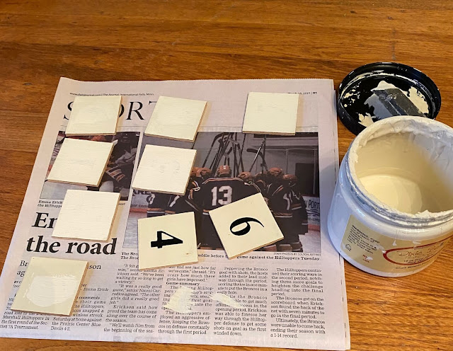 Photo of wooden squares being painted white