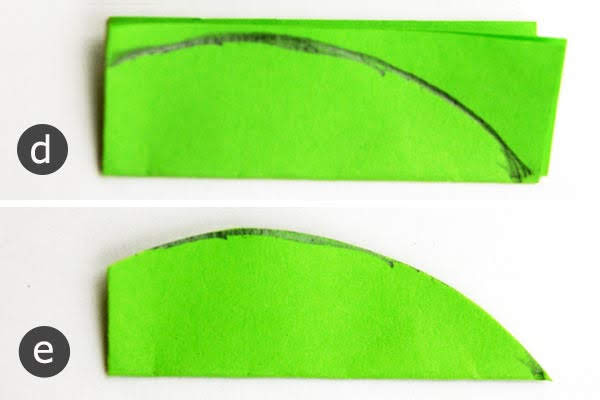Gambarlah bentuk setengah daun di sepanjang tepi yang terlipat panjang
