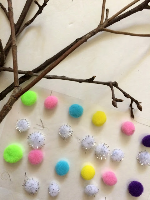 This project took about 10 minutes and was practically free, but the result is a cute pom pom tree branch decor!