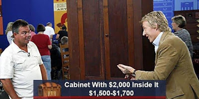 Cabinet with $2000 in it. Worth: $1500-$1700