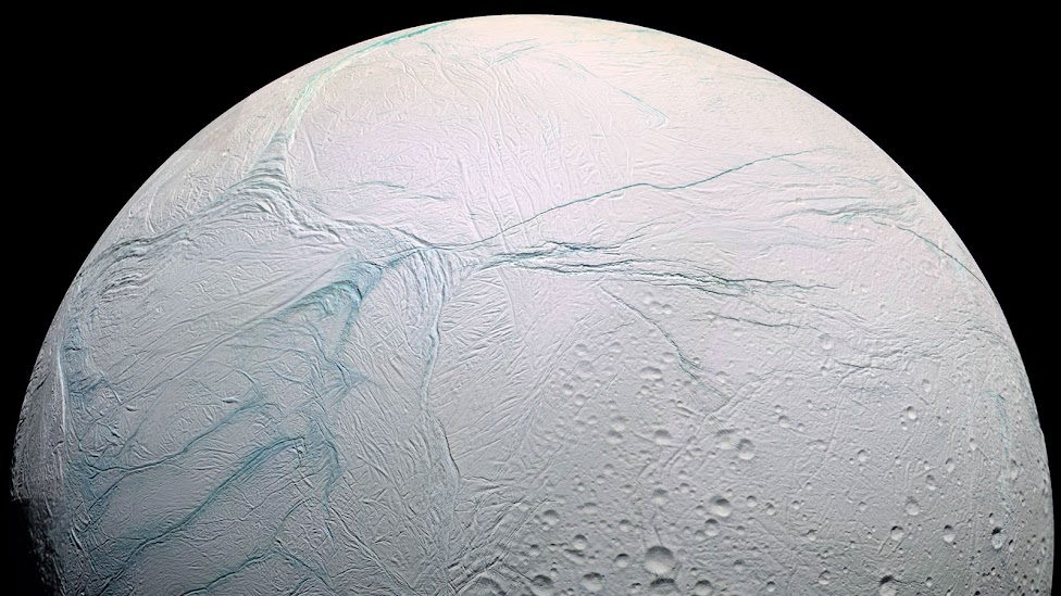 Long lines called tiger stripes are known by scientists to be spewing ice from the surface of Saturn's moon Enceladus, creating a cloud of fine ice particles over the moon's south pole. This photo from the Cassini spacecraft shows those tiger stripes — dubbed here in a false-color blue.